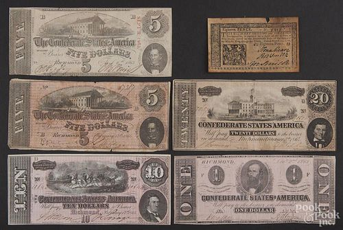 Confederate notes, to include a one dollar note in very good condition, a twenty dollar note in very